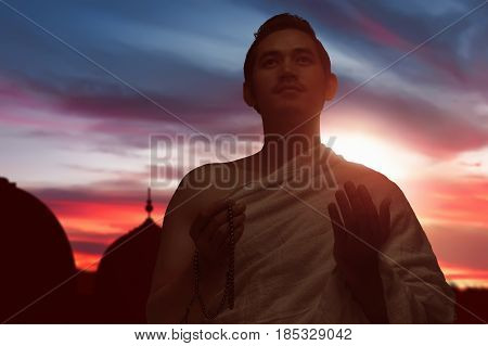 Asian Muslim Man With Ihram Clothes Praying To God