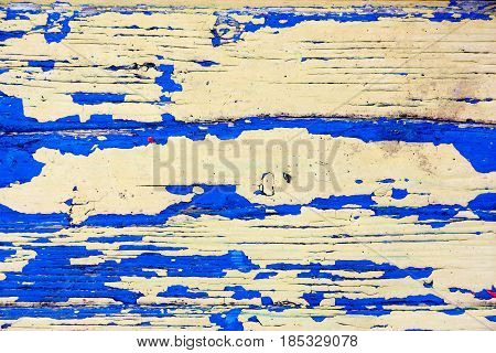 A wooden table with a shabby blue paint. Grunge. Background texture. Photo for your design.