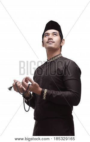 Religious Asian Muslim Man In Traditional Dress Praying