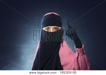 Beautiful Asian Muslim Woman In Veil Pointing With Upset Eyes