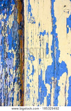 A board with a shabby blue paint. Grunge. Background texture. Photo for your design.
