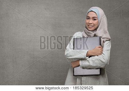 Beautiful Asian Muslim Woman Holding Laptop