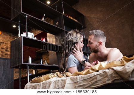 Love story in bed. Beautiful sensual couple