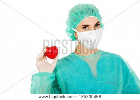 Female surgeon doctor holding heart