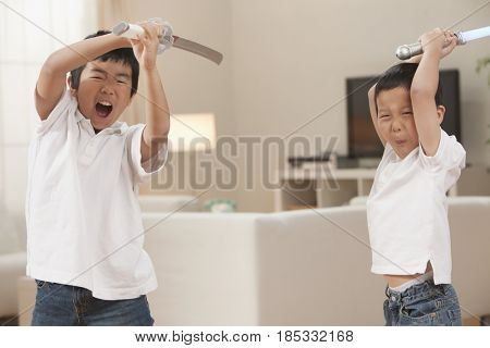 Korean brothers playing with swords