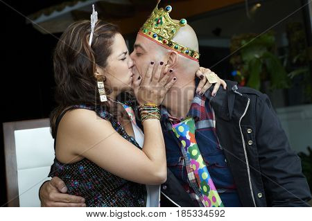 Hispanic couple kissing at party