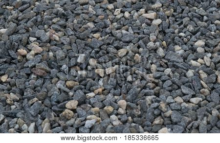 The texture of homogeneous fine gravel of gray shades