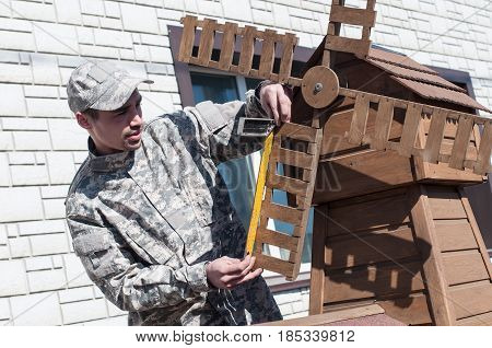 A young man modifies the detail of a decorative. Creative work hobby