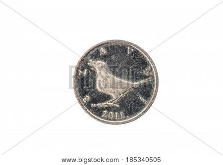 Old used and worn out 1 kuna coin. Coin of croatian currency for one kuna isolated on white. High resolution picture.