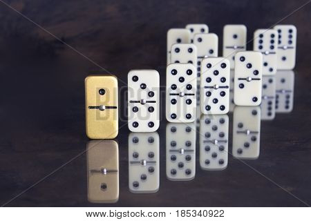 Business concept - Unique domino standing out from the rest - background with text space