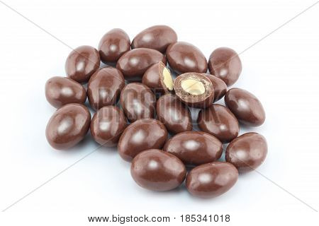 Chocolate covered nut balls in a group isolated on white background