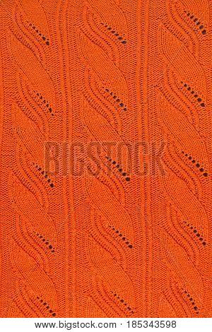 texture of an orange knitted openwork pattern closeup