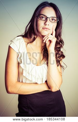Thinking young woman wearing glasses