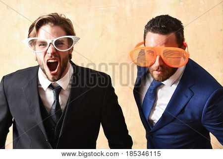 Office Relationship Concept. Handsome Bearded Businessmen With Funny Glasses