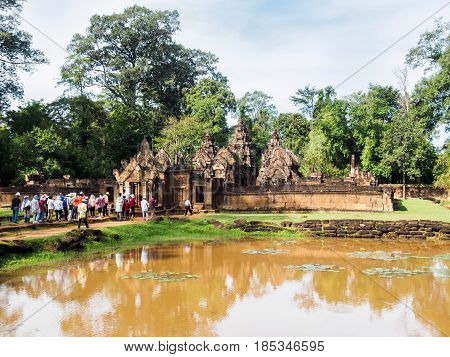 Siem Reap Cambodia - October 30 2016: Tourists visit the Banteay Srey or Banteay Srei Temple which is the 10th century Hindu temple in Siem Reap Cambodia.