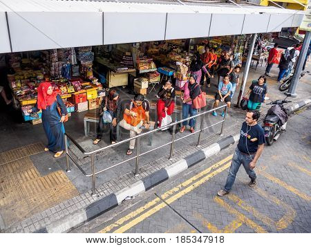 Penang Malaysia - June 02 2016: People waiting for buses at a Bus Stop of Penang Road George Town the capital of Penang State Malaysia.