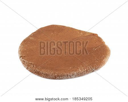 Rolled up thin layer of cookie dough isolated over the white background