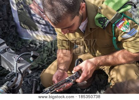 Unidentified Israeli Soldier With Fragment Of Hand Weapon