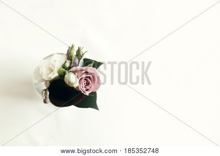 Stylish Rustic Boutonniere On White Table With Space For Text, Top View. Arrangements For Wedding Da