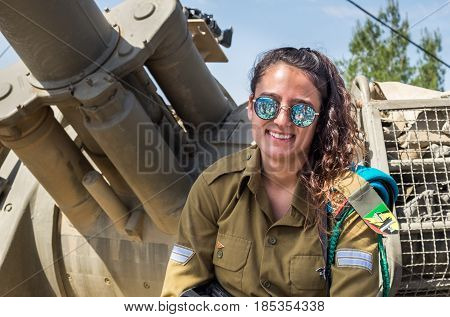 Unidentified Israeli Girl-soldier Sit On Tank Armour At Latrun Armored Corps Museum