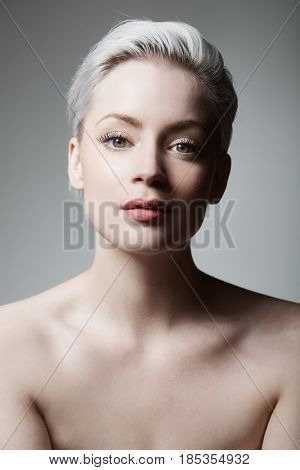 Closeup portrait of natural beauty woman with bare shoulders.