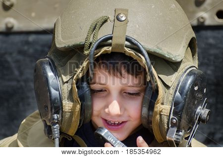 LATRUN ISRAEL - MAY 02 2017: Unidentified little boy wearing protective tank helmet at Latrun Armored Corps Museum