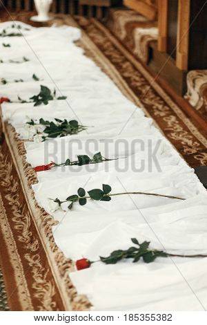 White Silk Textile At Aisle With Red Roses, Decor In Church At Wedding Ceremony, Spiritual Place