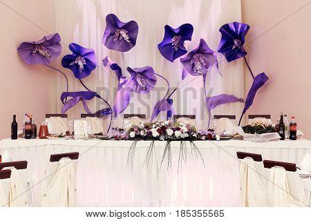 Big Purple Flowers At Wedding Centerpiece For Bride Groom Setting In Restaurant, Luxury Wedding Rece