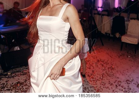 Woman Dancing, Having Fun At Wedding Reception Party. Guests At Dance In Restaurant, Motion Lights.