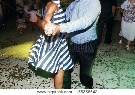 Couple Dancing, Having Fun At Wedding Reception Party. Guests At Dance In Restaurant, Motion Lights.