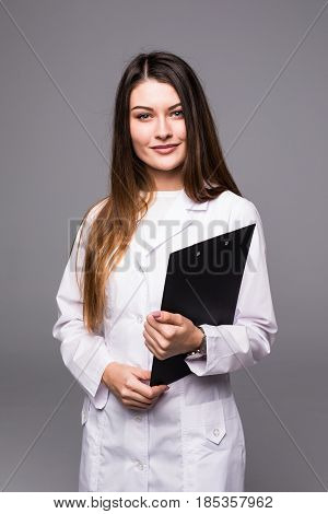 Young Doctor Medical With Clipboard On Grey Background