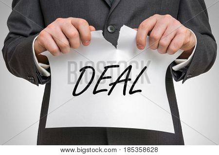 Businessman Tearing Paper With Deal Word