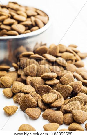 Dry kibble dog food on table.