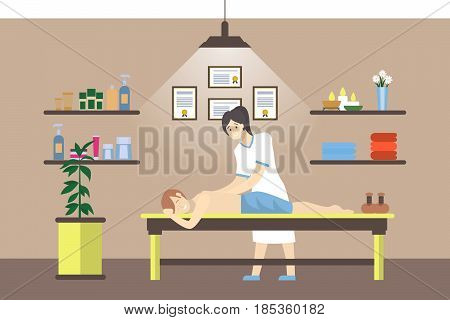 Massage in the spa salon. Woman does massage for man in cabinet.