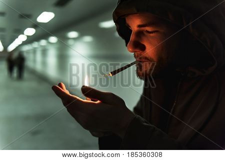 Homeless Adult Man Lightening Up Cigarette Addiction