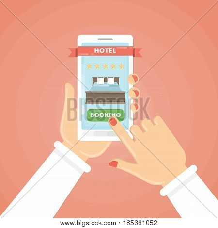 Online hotel booking. Female hands holding smartphone to book a room in the hotel.