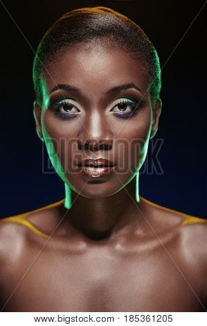 Beauty Portrait Of African American Woman. Studio Portrait On Dark Background