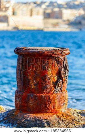 Old rusty marine bollard at port of Sliema Malta EU