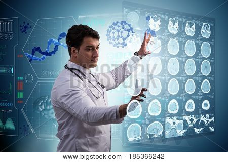 Male doctor studing x-ray image of MRI scan