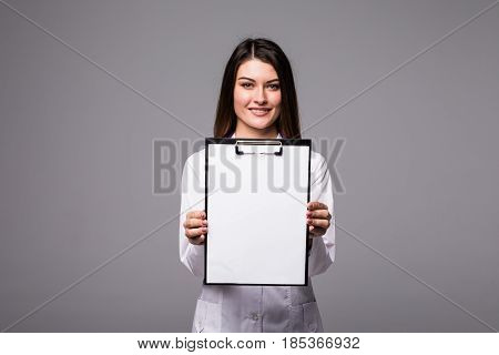 Young Female Doctor Holding Empty Folder With Files Of Desease Illness. Specialist Point By Pen Blan