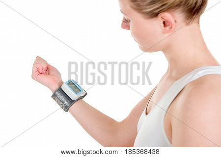 Woman measuring blood pressure and herself with tonometer or automatic blood pressure monitors