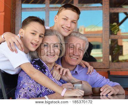 Portrait of a happy grandparents with their grandchildren