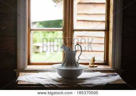 Old vintage objects wood concept. Old vintage window and ceramic jug in foreground