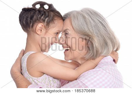 Portrait of grandmother and little granddaughter on white background