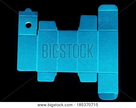 Real view of die line template of a blue cardboard box against black background