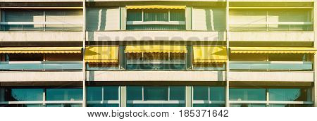 Panoramic view over French Balconies with awning opened - covered by sun-shield on a warm summer day