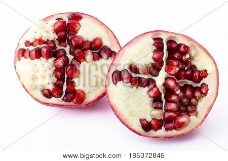 A pomegranate cut in two on a white background