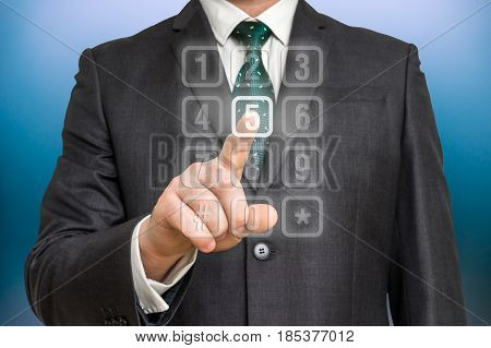 Businessman Pressing Numerical Button On Virtual Touch Screen
