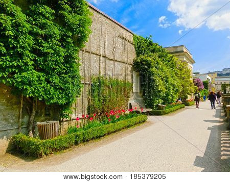 The beautiful Mirabell gardens in Salzburg. It is a popular destination visited by tourists at Salzburg, Austria on May 01, 2017
