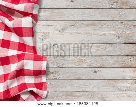 red picnic tablecloth on white wood background